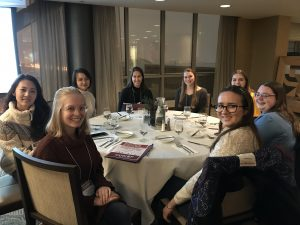 UW undergrad women at a table during the conference dinner
