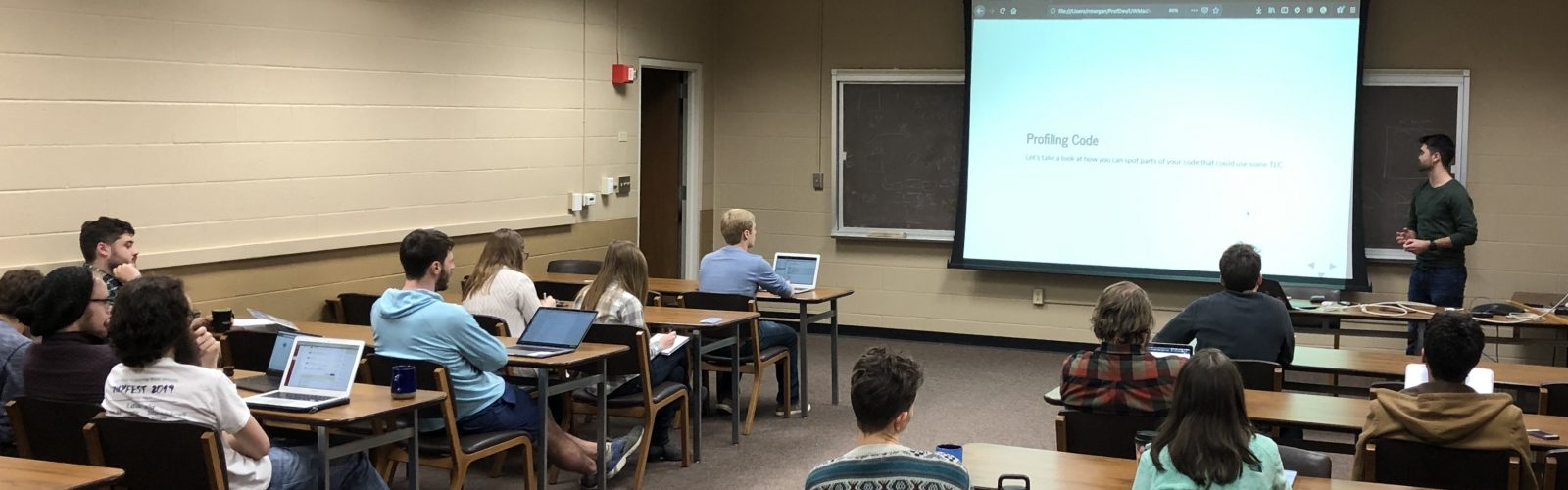 a conference room with students viewing a professional development presentation