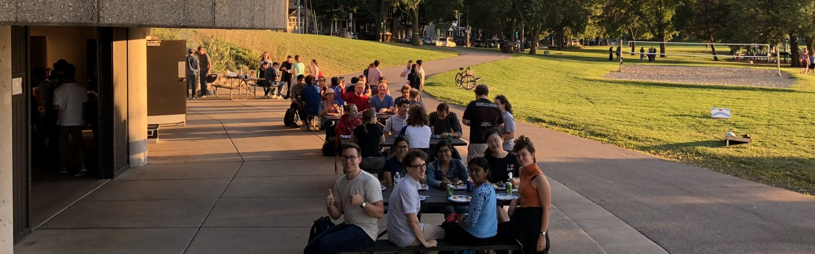 students in a park eating at tables