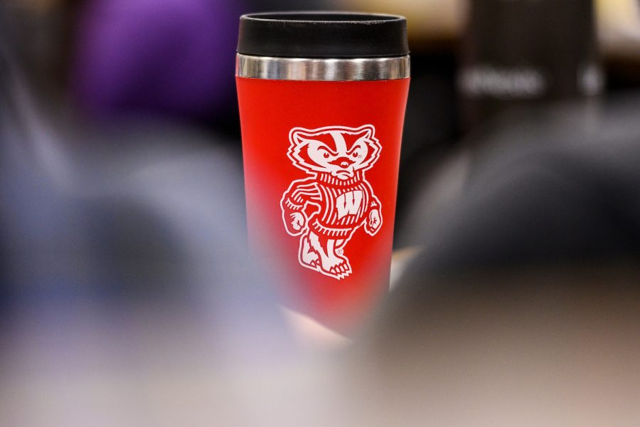 a red coffee tumbler with Bucky Badger on it
