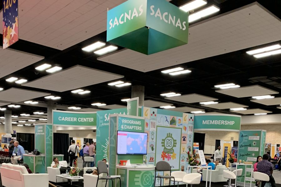 the conference hall at SACNAS 2020 with booths visible, no people in the shot, and a large SACNAS banner at the top
