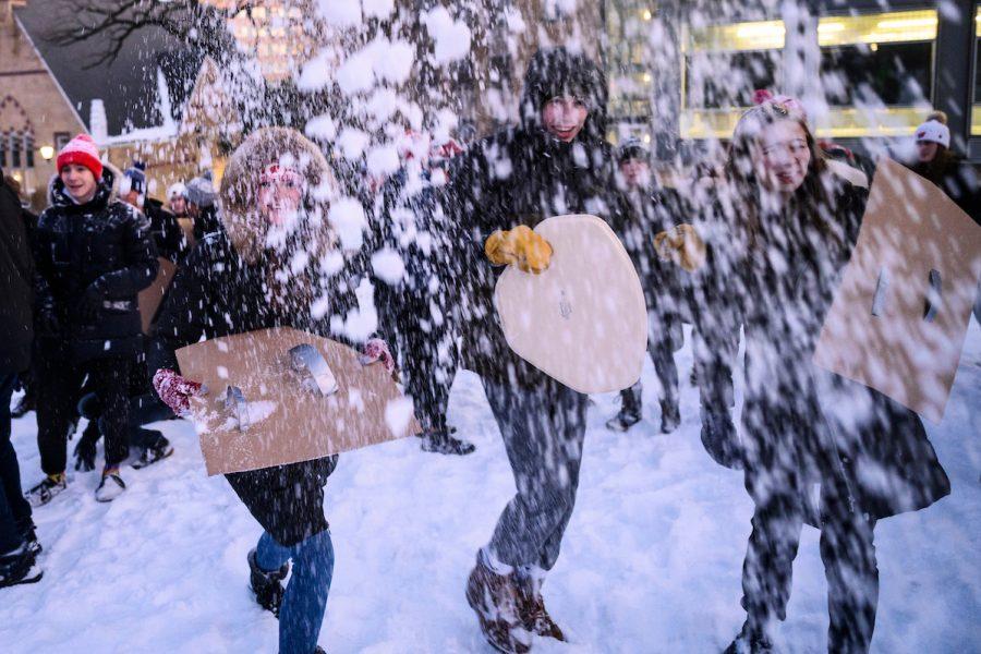 people throwing snowballs