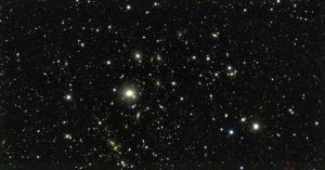a black background with lots of small bright white stars