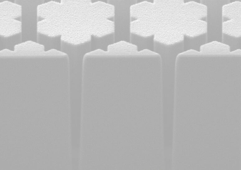 greyscale abstract image of things that appear to look like 3D towers in the shape of snowflakes